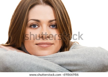 Close-up portrait of a young happy woman against white background - stock photo