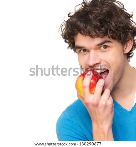 Close up portrait of a young man eating apple - stock photo