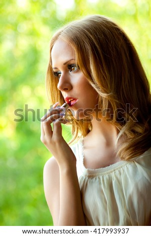 Close up portrait of a young woman - stock photo