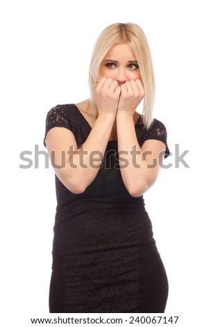 Close-up portrait of a young woman scared and afraid isolated on a white background - stock photo