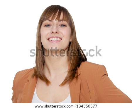 Close up portrait of a young woman smiling - stock photo