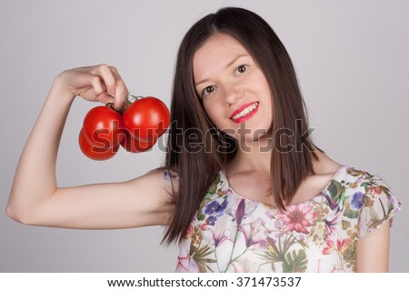 Close-up portrait of a young woman with a basket of fresh vegetables. Happy girl with carrots, reddish, onion and tomato. Vitamins and minerals. Healthy food concept. Grocery. - stock photo