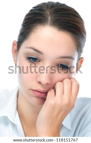 Close up portrait of a young woman with sad expression - stock photo