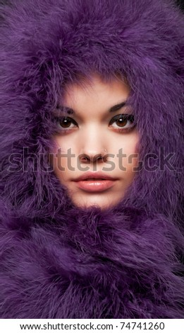 close-up portrait of alluring woman in violet fur - stock photo