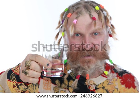 close-up portrait of an adult male with a beard, mustache and a variety of braids with a glass in hand on white background studio - stock photo