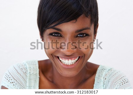 Close up portrait of an attractive african american woman smiling - stock photo