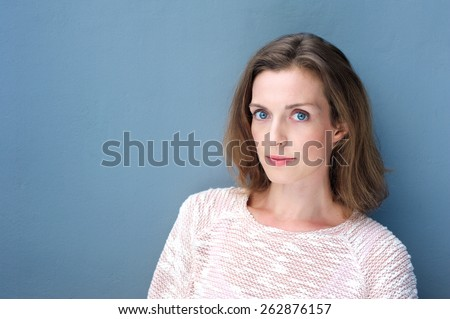 Close up portrait of an attractive woman with blue eyes - stock photo