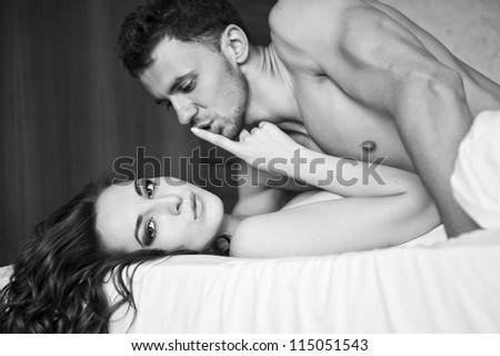 Close up portrait of an attractive young couple - stock photo