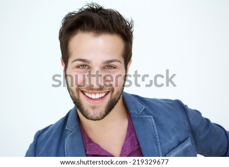 Close up portrait of an attractive young man with beard smiling on white background  - stock photo