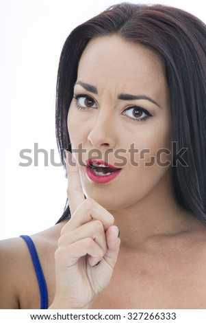 Close Up Portrait of an Attractive Young Woman Looking Concerned With A Finger Raised Isolated Against a Plain White Background - stock photo