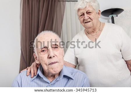 Close-up portrait of an elder couple at home - stock photo
