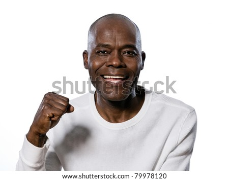 Close-up portrait of an excited afro American man clenching fist in studio on white isolated background - stock photo