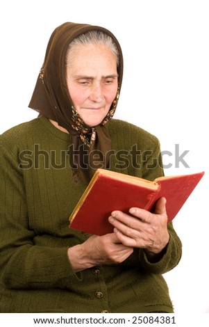 Close-up portrait of an old peasant woman reading a book, isolated on white background - stock photo