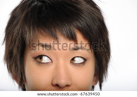 Close up portrait of Asian American woman looking to her left isolated over white background - stock photo