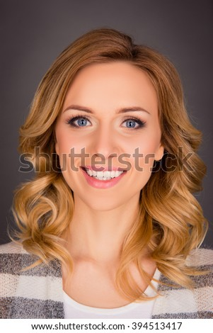 Close up portrait of attractive cheerful young woman with curly hair - stock photo