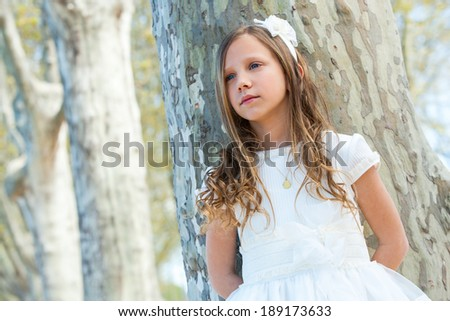Close up portrait of attractive girl in white outdoors. - stock photo