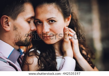Close up portrait of attractive young couple in love outdoors.  - stock photo