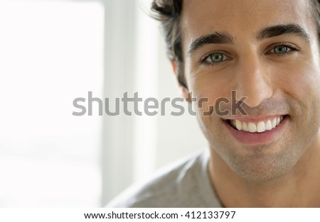 Close-up portrait of attractive young man - stock photo