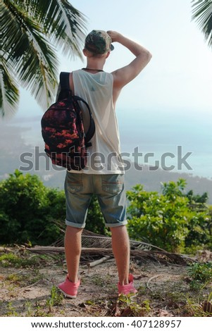 Close up portrait of bearded hiker man hiking living healthy active lifestyle. Trekking male model walking in beautiful mountain nature landscape on volcano Teide, Tenerife, Canary Islands, Spain.  - stock photo