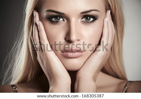 close-up portrait of beautiful blond girl. beauty woman.make-up - stock photo