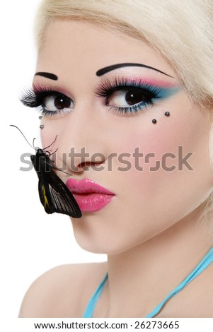 Close-up portrait of beautiful blond girl with bright makeup and black tropical butterfly on her face - stock photo