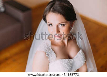 Close up portrait of beautiful caucasian mid adult bride. High angle view - stock photo