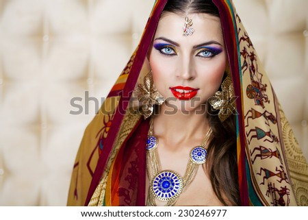 Close up portrait of beautiful eastern woman on a black background - stock photo