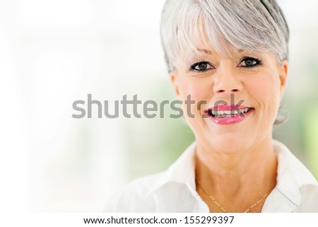 close up portrait of beautiful middle aged woman indoors - stock photo