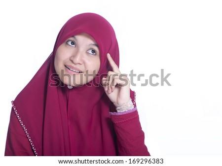 Close-up portrait of Beautiful Muslim Girl thinking. Over white background  - stock photo