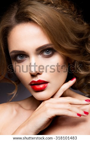 Close-up portrait of beautiful woman with bright make-up - stock photo