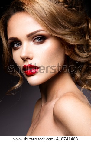 Close-up portrait of beautiful woman with bright make-up and red lips - stock photo