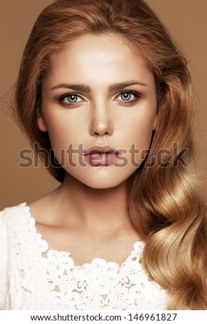 Close-up portrait of beautiful woman with nude make-up - stock photo