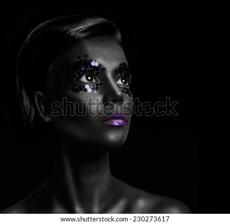 Close-up portrait of beautiful woman with professional make-up Fashion Model Girl. black background - stock photo