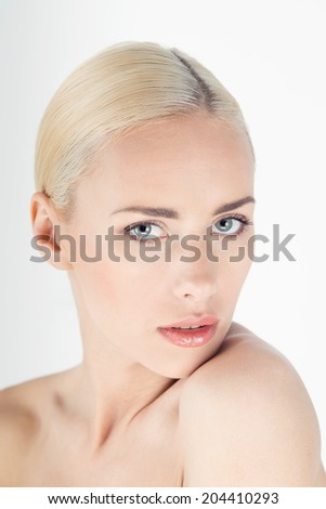 Close-up portrait of beautiful young blonde woman with healthy shiny face isolated on white background - stock photo