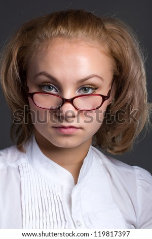 close up portrait of beautiful young woman bespectacled - stock photo