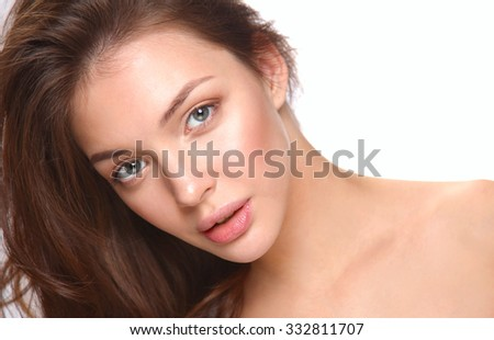 Close up portrait of beautiful young woman face. Isolated on white background. - stock photo