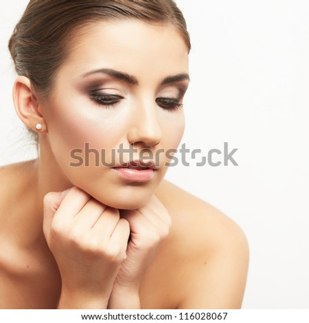 Close up portrait of beautiful young woman face. Isolated on white background. Portrait of a female model. - stock photo
