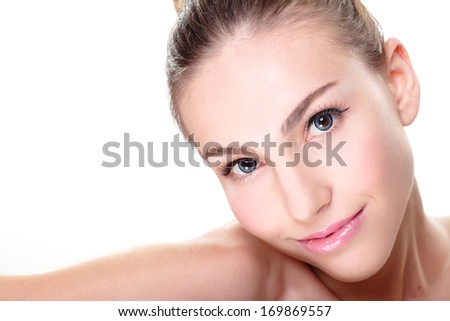 Close up portrait of beautiful young woman face while lying. Isolated on white background. Skin care or spa concept - stock photo