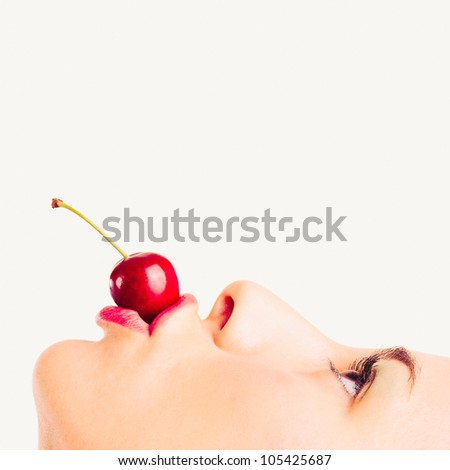 Close up portrait of beautiful young woman with cherry against white background. - stock photo