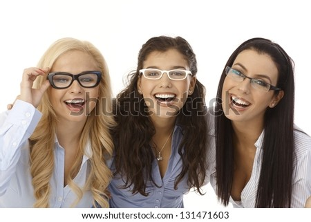 Close-up portrait of beautiful young women wearing glasses, smiling happy, looking at camera. - stock photo