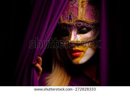 close up portrait of beauty young woman in venice mask - stock photo