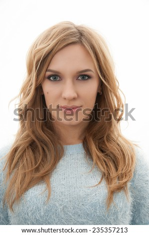 Close-up portrait of blond woman face head with make-up isolated on white background - stock photo