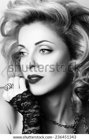 Close-up portrait of blonde sexual thoughtful mature woman wearing lacy gloves. Black and white photo. - stock photo