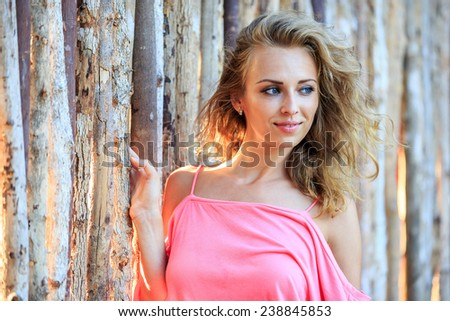 Close-Up Portrait Of Blonde Woman Looking Away And Smiling - stock photo