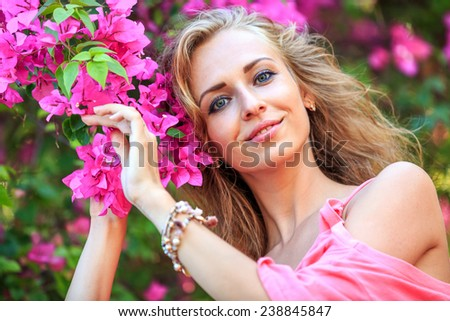 Close-Up Portrait Of Blonde Woman Looking In Camera And Smiling - stock photo