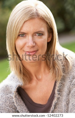 Close Up Portrait Of Blonde Woman Outdoors - stock photo