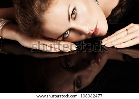 close-up portrait of blonde woman with red lips - stock photo