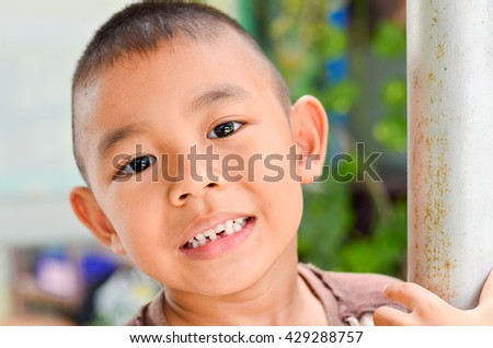 Close up portrait of boy laughing looking at camera portrait.Close up face with smiling kid. - stock photo