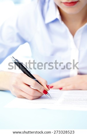 Close-up portrait of businesswoman filling the form on job interview. Business person sitting at desk while working at office.  - stock photo