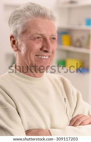 Close-up portrait of cheerful mature man at home - stock photo